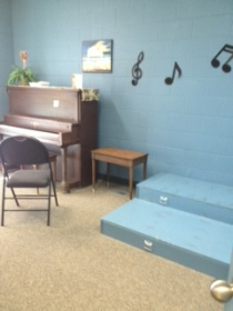 Music room with piano.